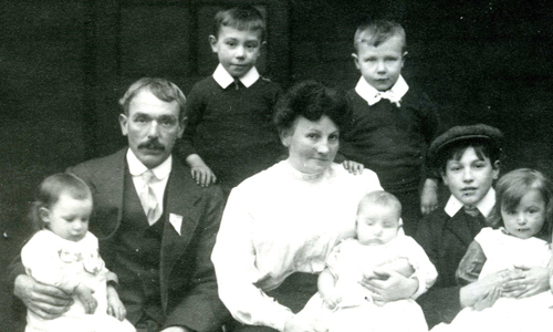 Black and white family photograph, parents and six children